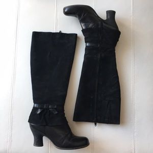 Black suede heeled boots with bows